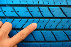 Old blue tire with hand Royalty Free Stock Image