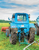 Old blue tractor at farm Stock Images