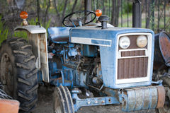 Old Blue Tractor In Outdoors Open Shed Royalty Free Stock Images