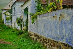 Small village detail. Old blue traditional houses in a small village stock images