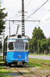 Old blue tram. In the city Stock Photos
