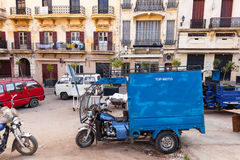 Old blue tricycle cargo bike on the street of  Tangier Royalty Free Stock Image