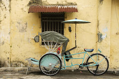 Old Blue Trishaw and Heritage House Royalty Free Stock Photo