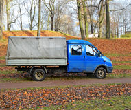 Old blue truck in an autumn garden Stock Photography