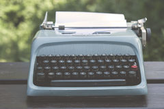 Old blue typewriter Royalty Free Stock Photography
