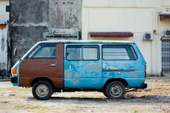 Old blue van at old building. Old blue van near old building Stock Images