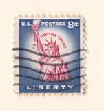 An old blue vintage american postage stamp with the statue of liberty in Manhattan royalty free stock photo