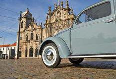 Old blue vintage car on old cobblestone road Royalty Free Stock Photos