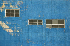 Old blue wall. With windows stock image