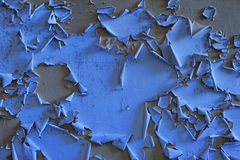 Old blue wall with flaky gray paint. Old vintage wall background with flaky paint stock photo