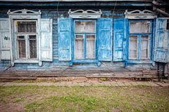 Old blue wall with some windows. Old blue wooden wall with some windows Royalty Free Stock Photography
