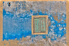 Old Window. An old blue wall with wooden window Stock Image