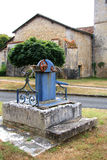 Old Blue Water Pump. With old stone base, France Royalty Free Stock Photo