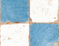 Old blue and white ceramic tiles with peeling paint stock photos