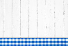 Old blue white checked wooden background with fabrics. Stock Image