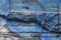 Texture of the old wall of shabby stucco and elements of graffiti royalty free stock photo