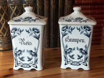Old blue and white pottery storage jars stock images
