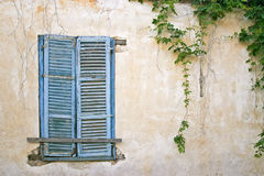 Old blue window on old wall. Vintage background. Royalty Free Stock Images