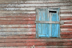 Old blue window of old wooden house Royalty Free Stock Image