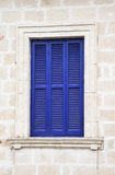 Old blue window with shutters closed Stock Image