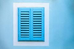 Old blue window with wooden shutters Royalty Free Stock Photo