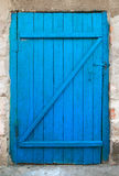 Old blue wood door. Old wood door painted with blue color Royalty Free Stock Photography