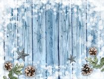 Old blue wood holiday background with snow frame and decorations. Table top view. Christmas design element for product placement. Copy space for text royalty free illustration