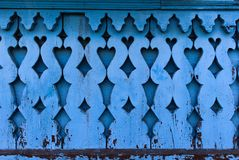 Old blue wooden carving for background stock photography