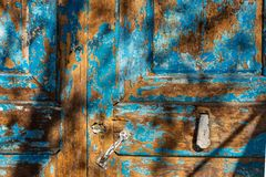 Old blue wooden door  backround with shadows. Stock Image