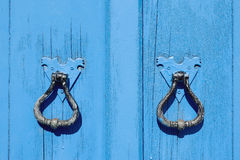 Old blue wooden door. With round handles Stock Images