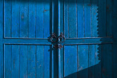 Old blue wooden door Stock Images