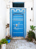 Old blue wooden door and white walls. Medina, historical part of Stock Photo