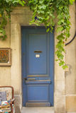 Old blue wooden entrance door Stock Photography