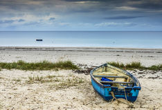 Old blue wooden fishing boat Stock Photo