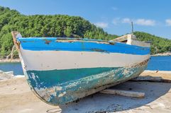 Old blue wooden shabby fishing boat. Close Stock Image