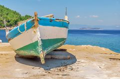 Old blue wooden shabby fishing boat Stock Photos