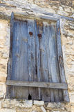 Old blue wooden shutter doors in a old barn Stock Images