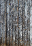 Old blue wooden wall. Old faded blue wooden wall, vertical boards as background stock photos