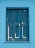 Old blue wooden window in Greece Stock Photo