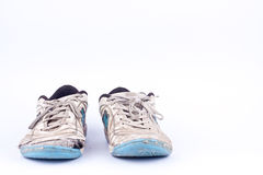 Old blue worn out futsal sports shoes  on white background  isolated Royalty Free Stock Photography