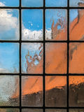 Old  blurry glass window. View through the old glass window Royalty Free Stock Photography