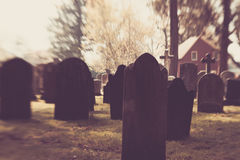 Old Blurry Tombstones. Old blurred tombstones are seen in a cemetery Stock Image