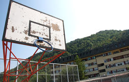Old board and hoop on the basketball court, Serbia Stock Photos
