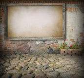 Old board on stone wall Stock Image