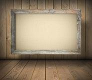 Old board on wooden wall Royalty Free Stock Photography