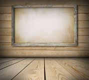Old board on wooden wall Royalty Free Stock Photos