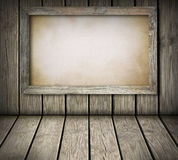 Old board on wooden wall Royalty Free Stock Images