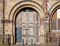 Old boarded up arched doorway Stock Photo