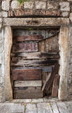 Old boarded up door texture. Old boarded up door in gray stone wall stock images