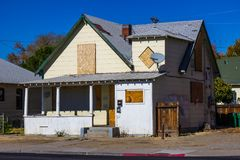Old Boarded Up Home Lost To Foreclosure. During Recession stock photos